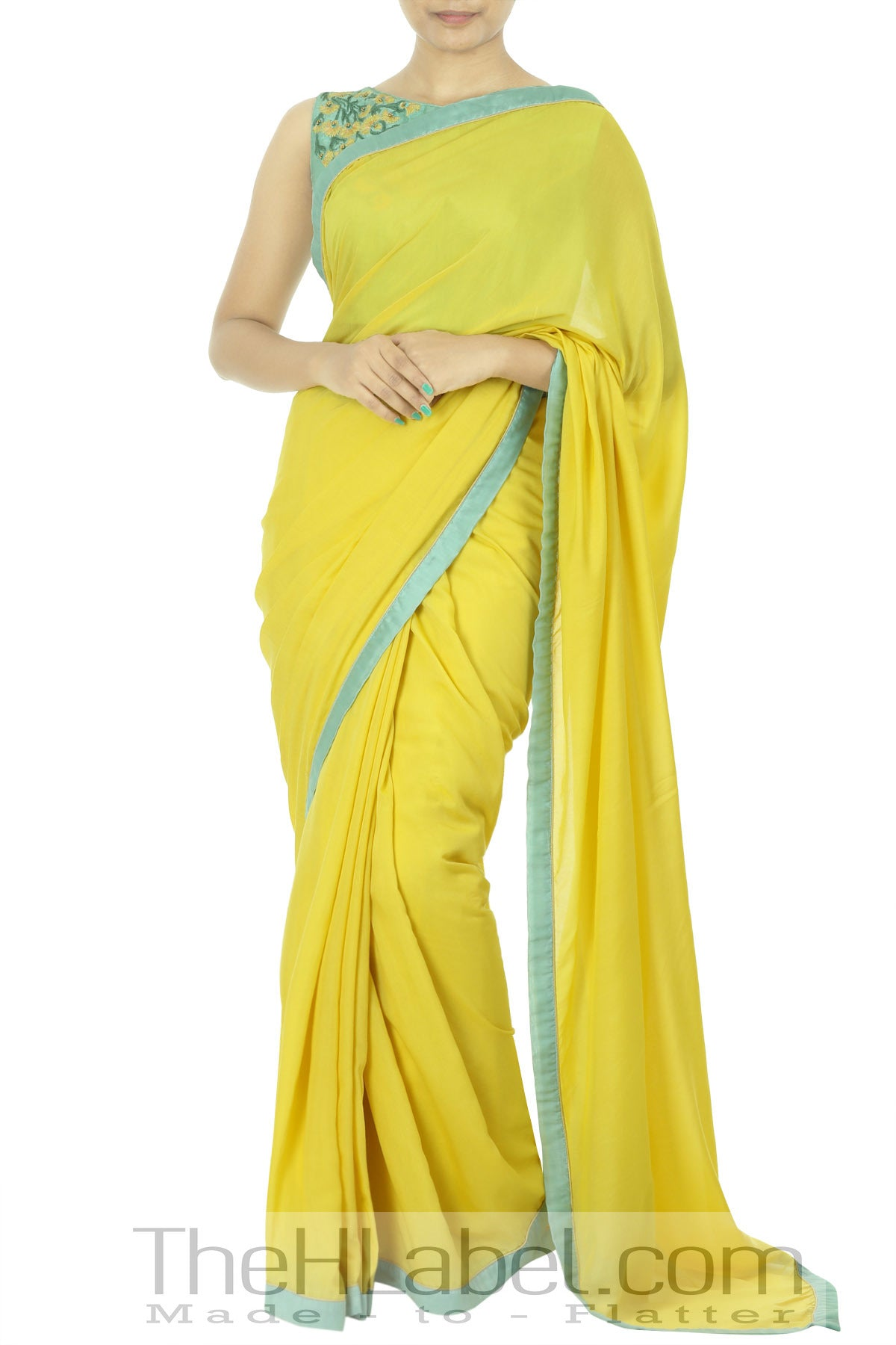 Pastel blue embroidered blouse with yellow saree