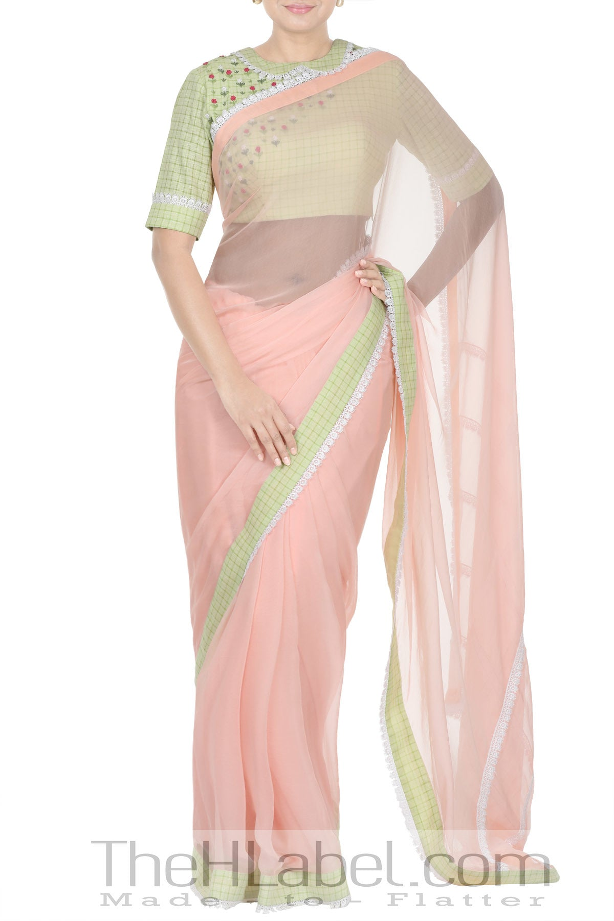 Green floral embroidery blouse with peach saree