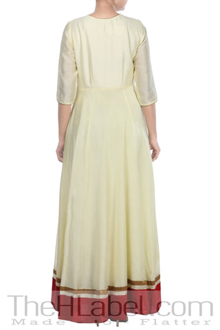Beige embroidered Anarkali paired with net dupatta