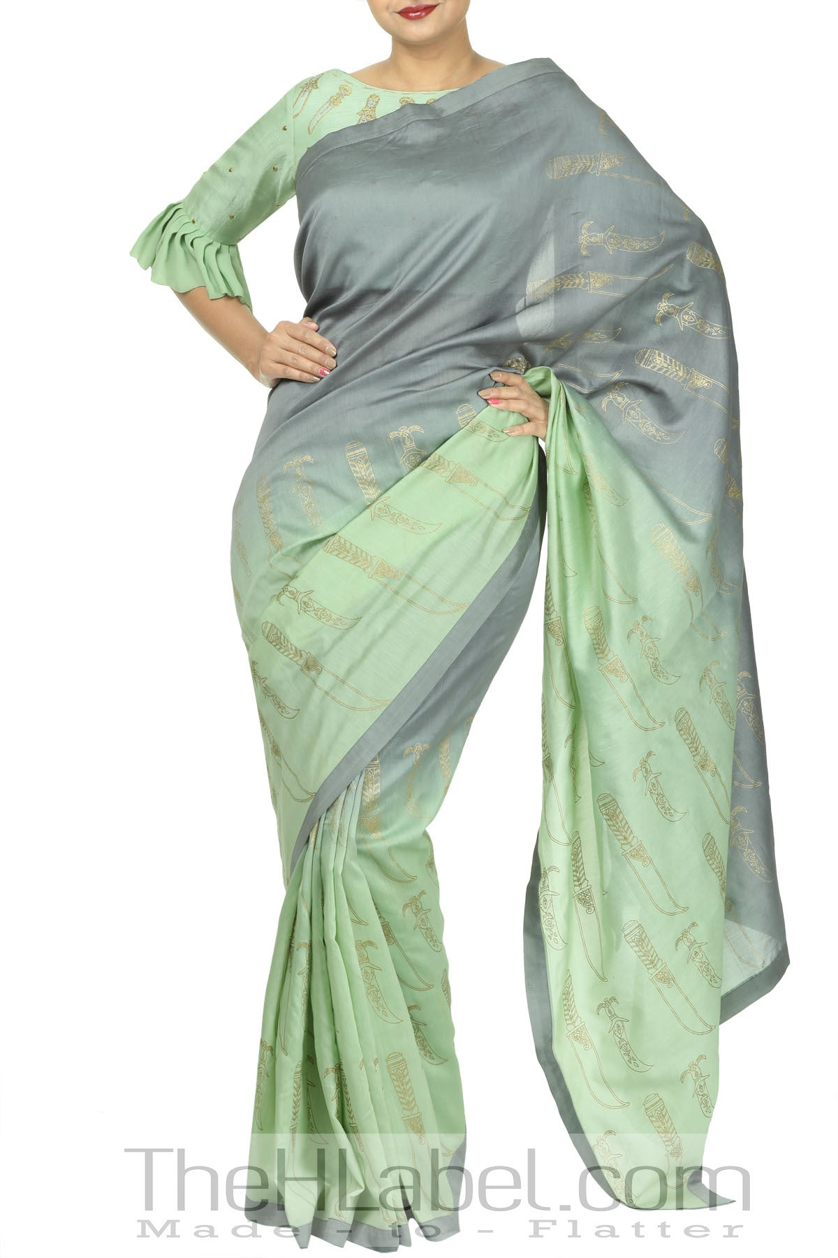 Ombre dyed dagger printed saree with bell sleeved printed & highlighting blouse