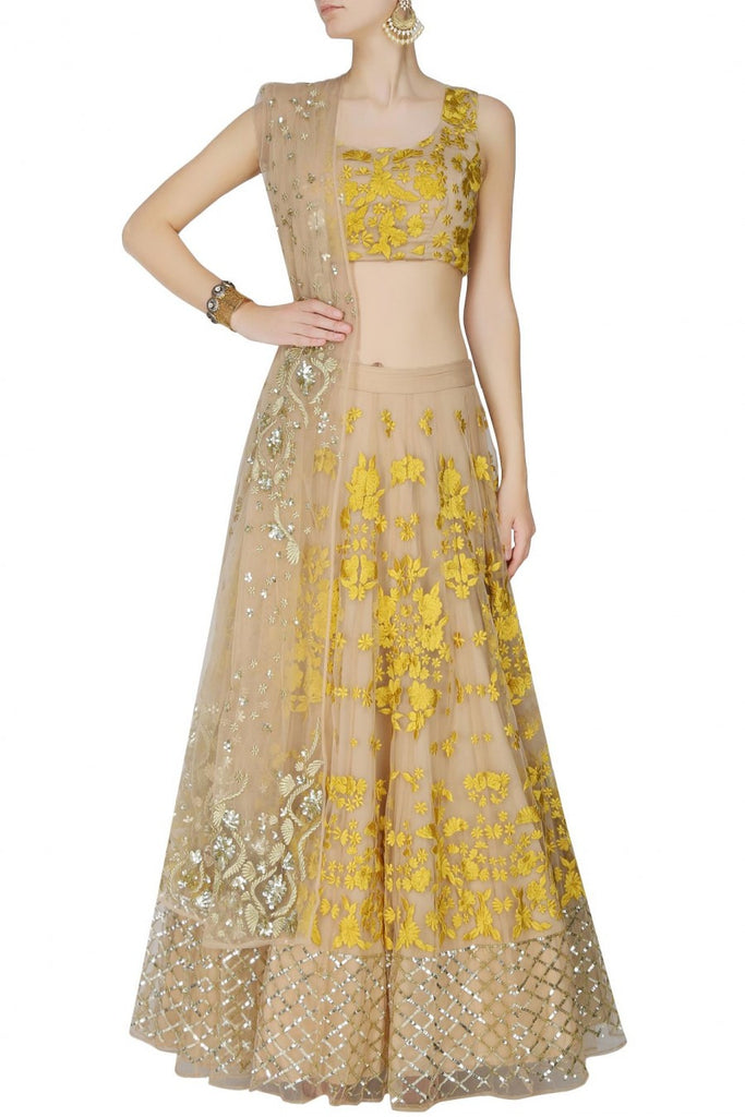 Peach lehenga choli with yellow embroidery