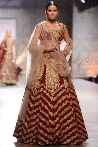 Raw silk lehenga choli in maroon colour