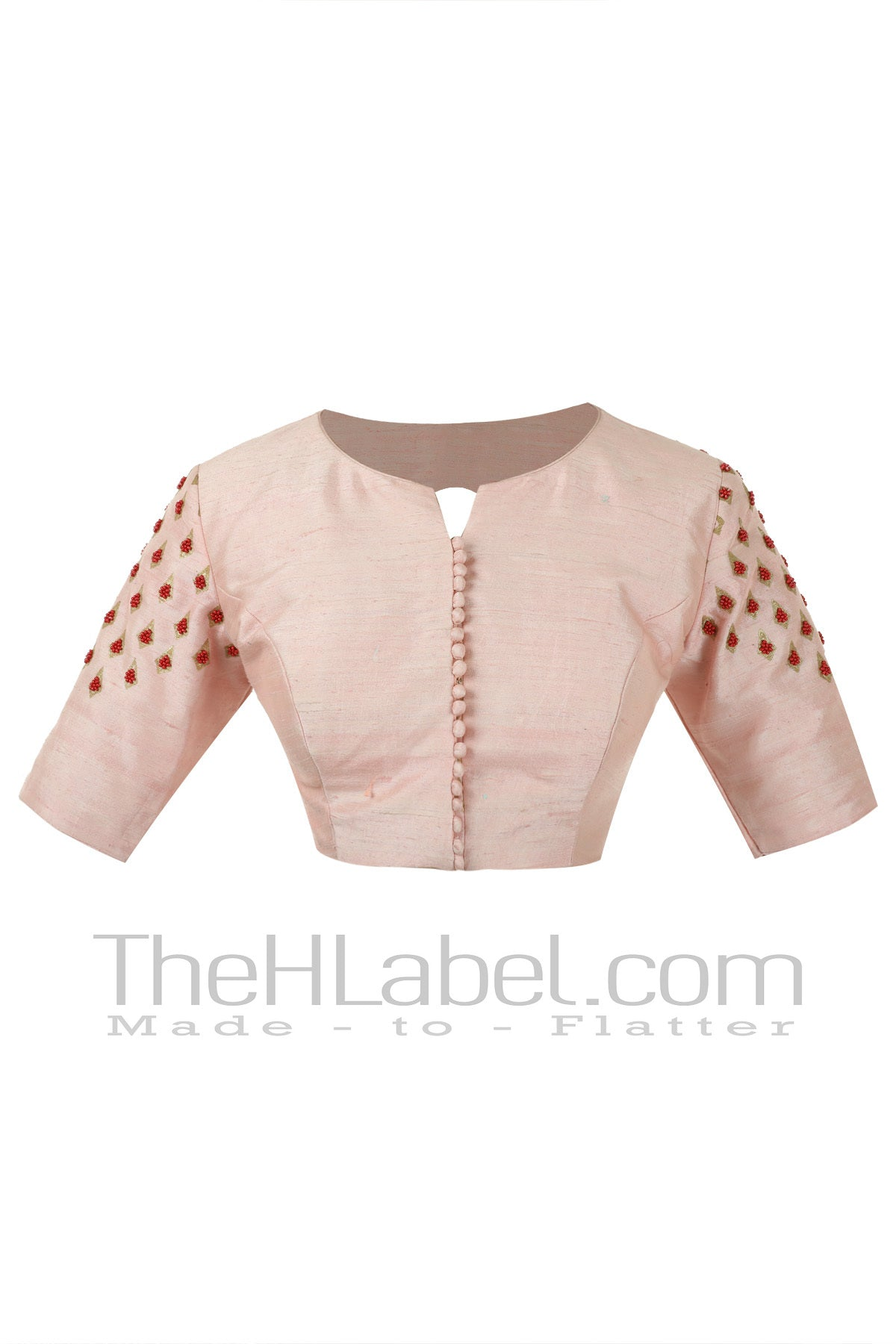 Peach blouse with hand embroidery on sleeves