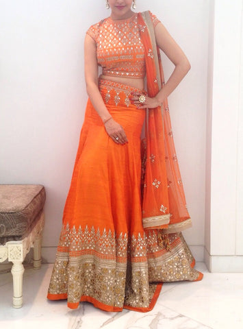 Orange color lehenga choli in Gotta patti work