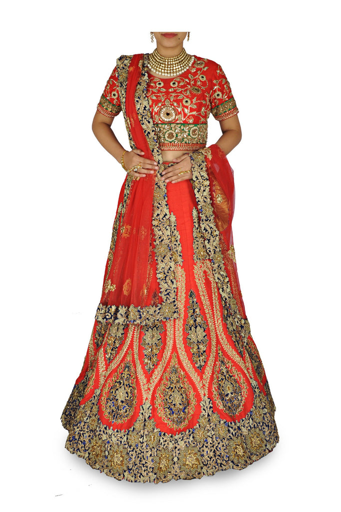 Red color wedding lehenga choli with blue border