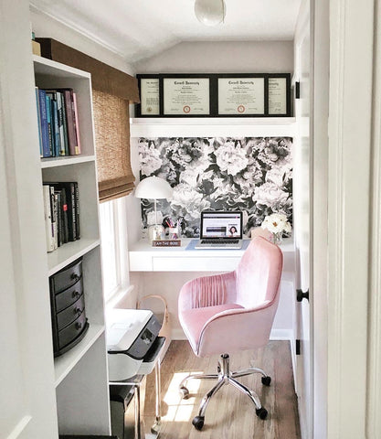 compact home office with floral wallpaper