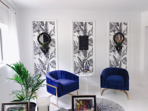 Black and white wallpaper panels against a white wall for a sophisticated home office vibe