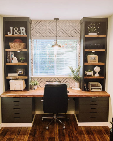 Olive green home office desk with an art-deco-inspired wallpaper