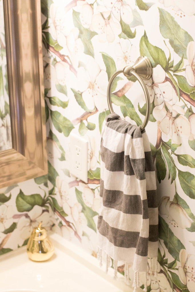 Coffee Beans and Bobby Pins uses WallsNeedLove's removable wallpaper to update her powder room.