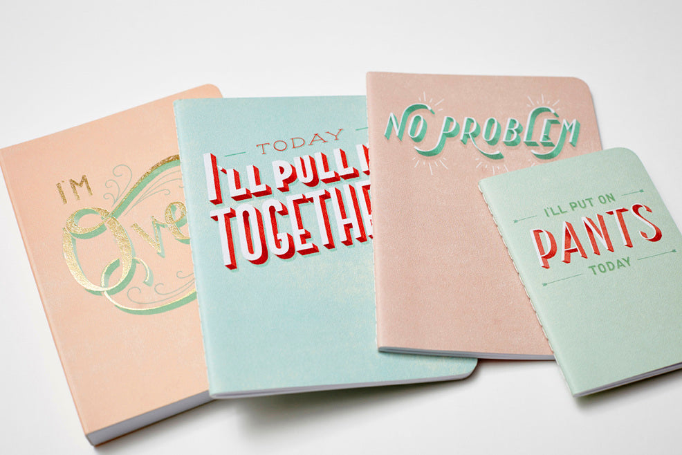 Handl lettering on books by Lauren Hom