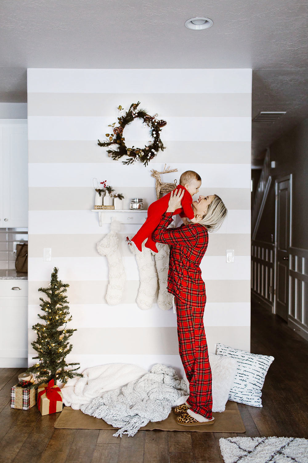 Holiday themed accent wall using Easy Stripe from WallsNeedLove