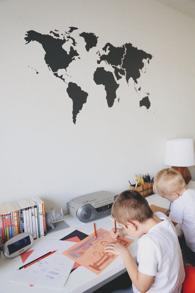 Merrick used WNL's World Map Vinyl Decal on her sons' bedroom wall and it's adorable.