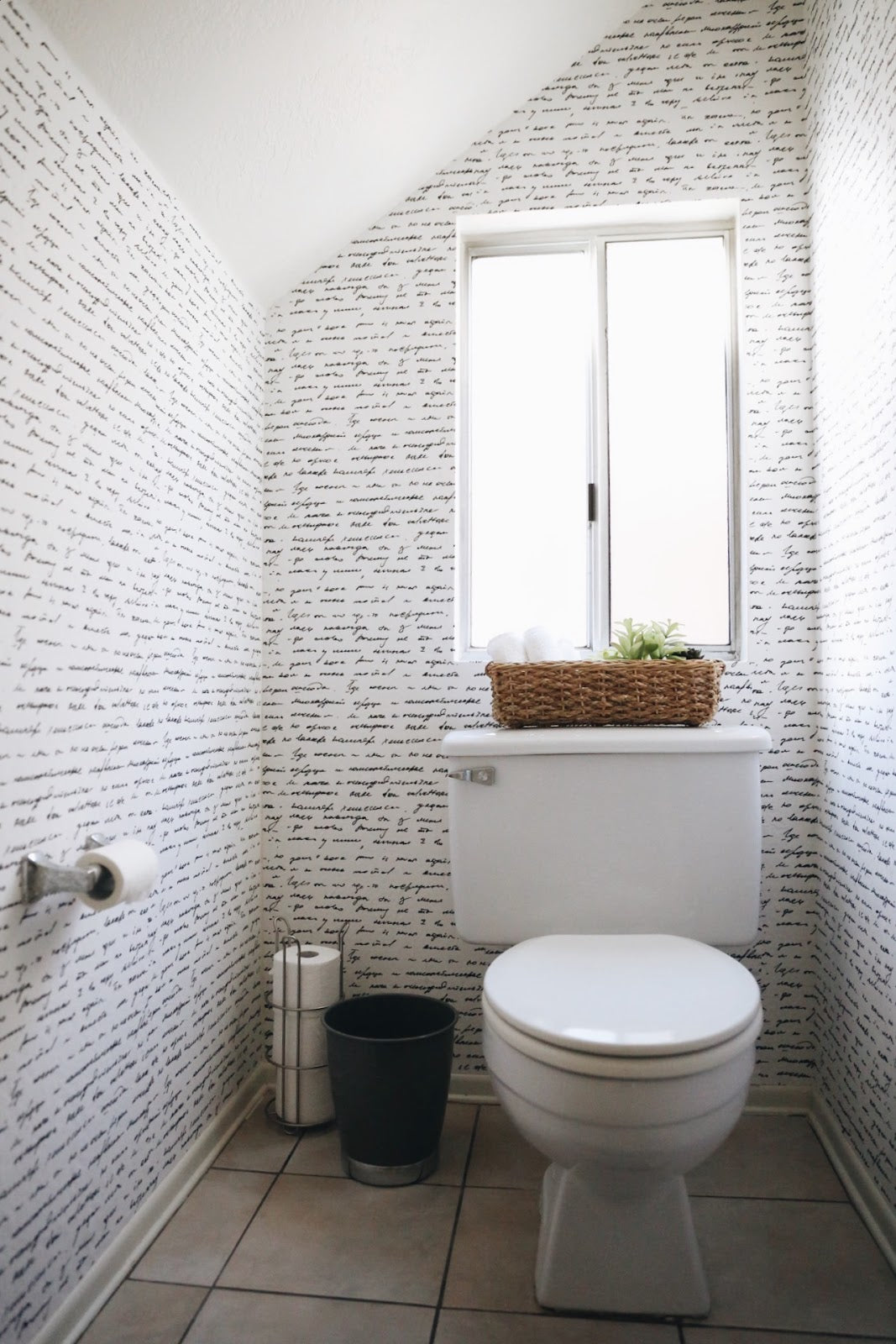 Powder room transformation using removable wallpaper from WallsNeedLove | Merrick's Art