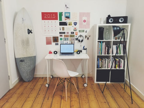 A surfboard accent piece for home office space
