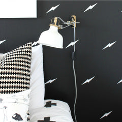 White lightning bolt decals on black wall courtesy of The Winthrop Chronicles