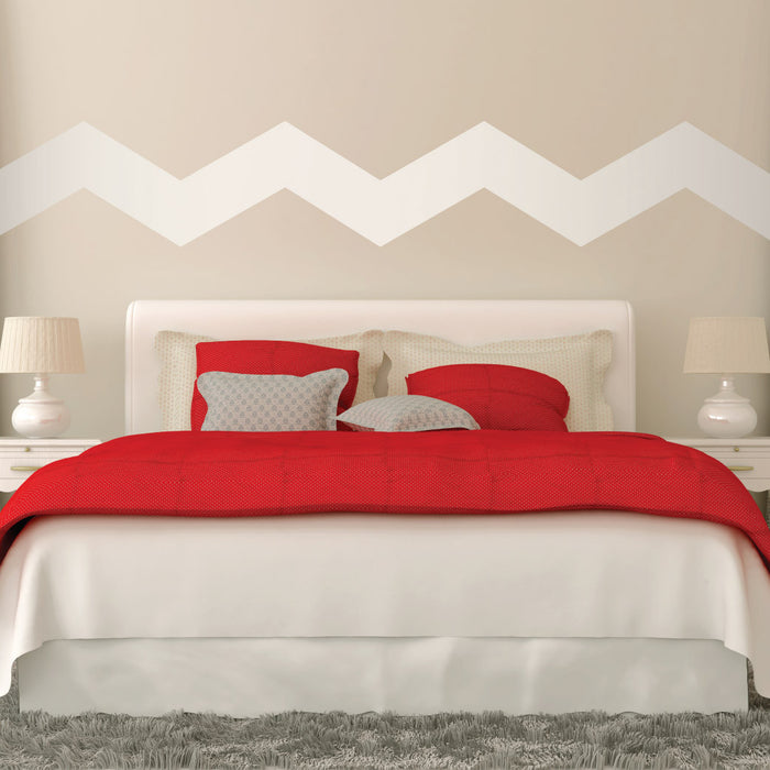 "7"" Wide Chevrons wall decal on wall behind bed 