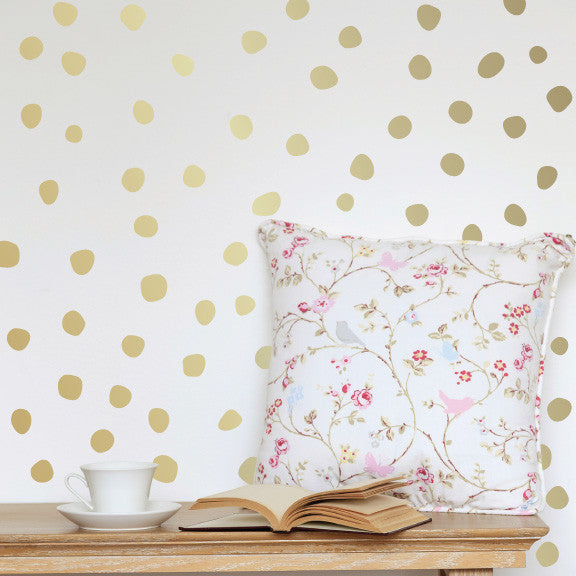 Perfectly Imperfect Dots Mini-Pack Wall Decals on wall behind the pillow | lifestyle