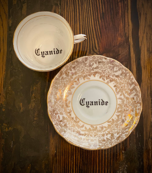 Cyanide | vulgar vintage Colclough gold china tea cup and saucer