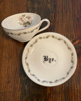 You've been poisoned. | Vulgar vintage floral tea cup with matching 'Bye.' saucer