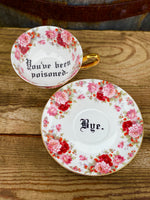 You've been poisoned. | Vulgar vintage style red floral tea cup with matching 'Bye.' saucer