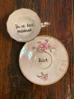You've been poisoned. | Vulgar vintage floral tea cup with matching 'Bitch' saucer