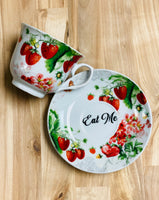 Eat Me | vulgar strawberry tea cup and matching saucer set