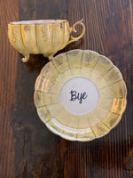 You've been poisoned. | Vulgar vintage opalescent tea cup with matching 'Bye' saucer