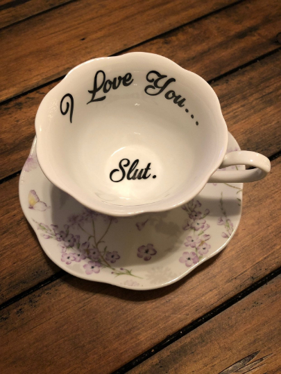 I love you... Slut. | Vulgar lavender tea cup with matching 'Slut.' saucer