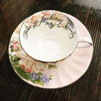 You're fucking lovely | vulgar vintage style pale pink tea cup with floral interior and matching 'Bitch' saucer set.