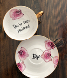 You've been poisoned. | Vulgar vintage style pink orchid floral tea cup with matching 'Bye.' saucer