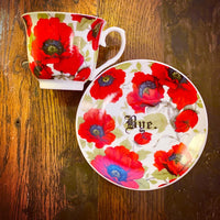 You've been poisoned. | Vulgar vintage style red and black poppy print tea cup with matching 'Bye.' saucer