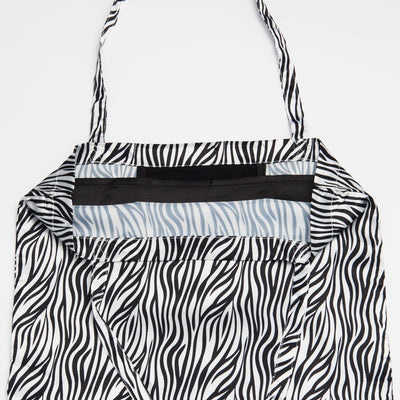 Black and White Zebra Stripe Patterned Shoezie Satin Tote bag, showing internal satin divider designed to separate and protect shoes from rubbing against each other
