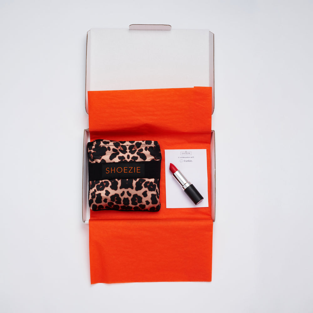 Gift pack showing Leopard Print patterned Shoezie shoe tote bag and Frankie Cosmetics Red lipstick