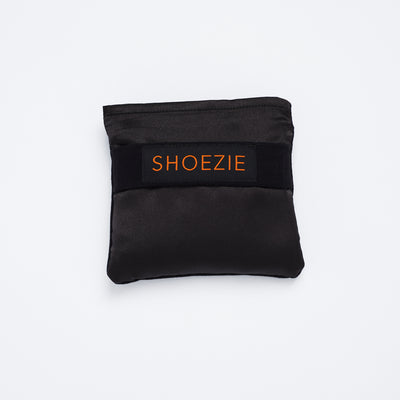 Black Shoezie Satin Tote bag, folded in pouch, designed for carrying shoes