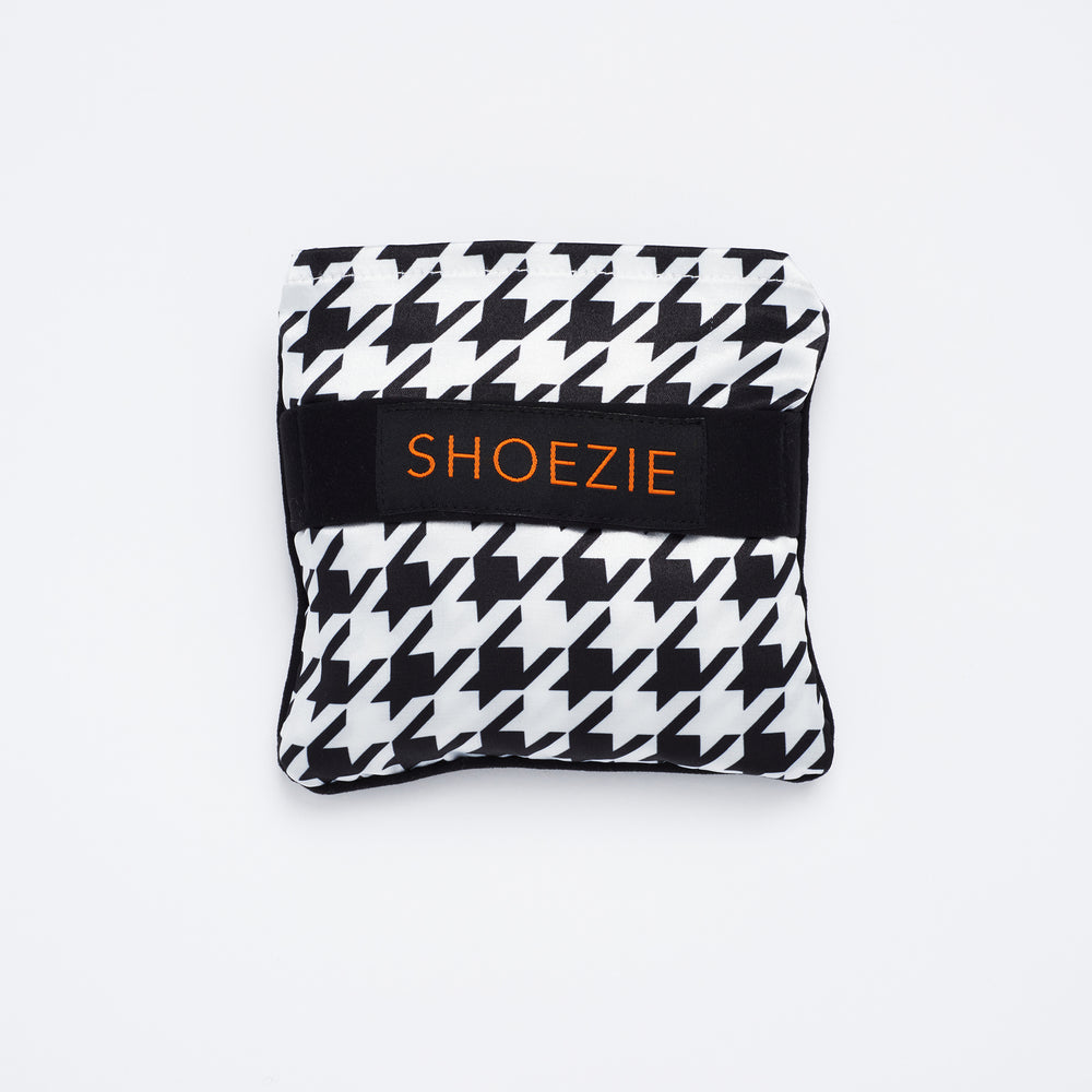 Black and White Houndstooth Patterned Shoezie Satin Tote bag, folded in pouch. The bag designed for carrying shoes