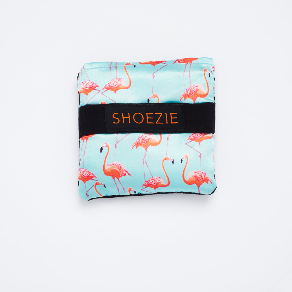 Blue and Pink Flamingo Patterned Shoezie Satin Tote bag, folded in pouch. The bag designed for carrying shoes