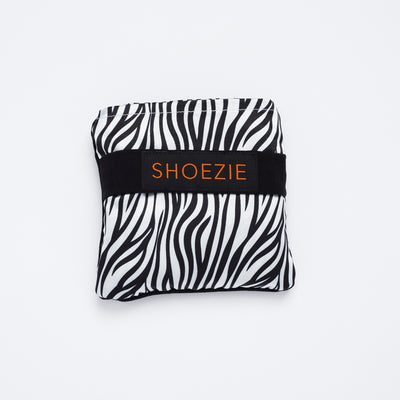 Black and White Zebra Stripe Patterned Shoezie Satin Tote bag, folded in pouch. The bag designed for carrying shoes