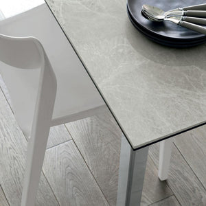 Saturno stoneware extending dining table by Target Point