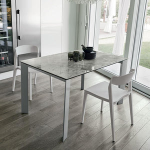 Saturno stoneware extending dining table