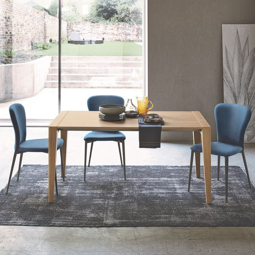 Taller fixed extending oak dining table by Sedit