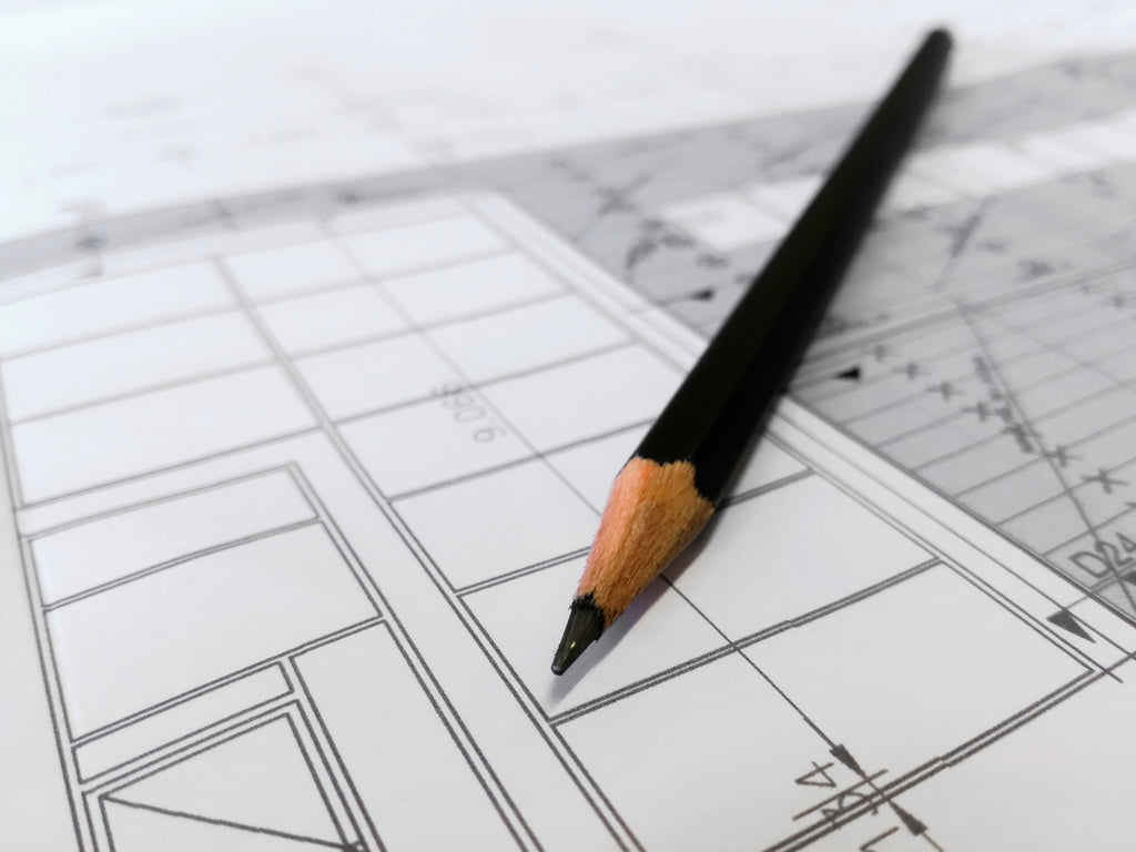 Image of pencil and floor plan for best floor plan software