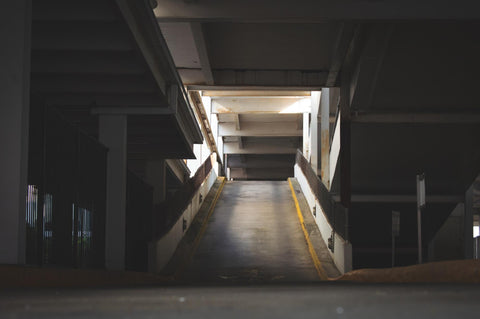 Source Alt text: a dramatically lit parking lot ramp