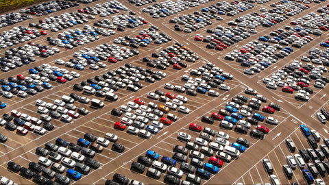 Alt text: a large stadium parking lot full of cars