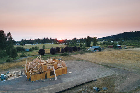 valley sunrise with unfinished house