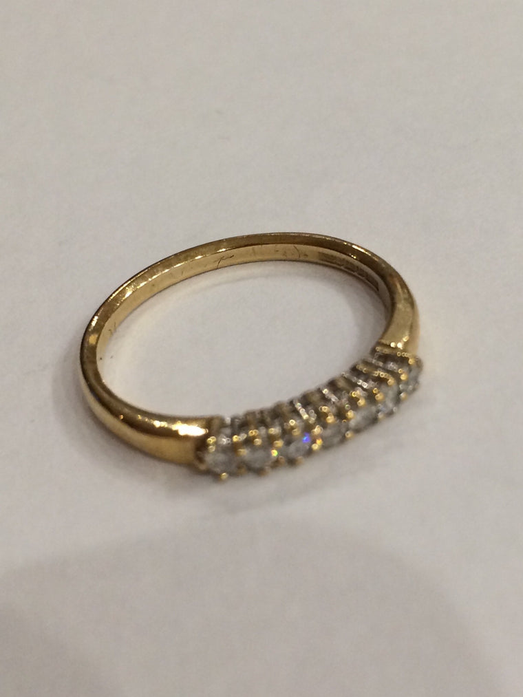 9CT YELLOW GOLD 0.10CTS CLAW SET ETERNITY RING