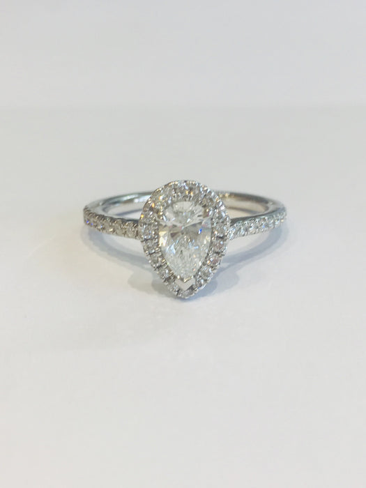 Platinum Pear Cut halo ring with stone set shoulders. Approx. 0.86cts