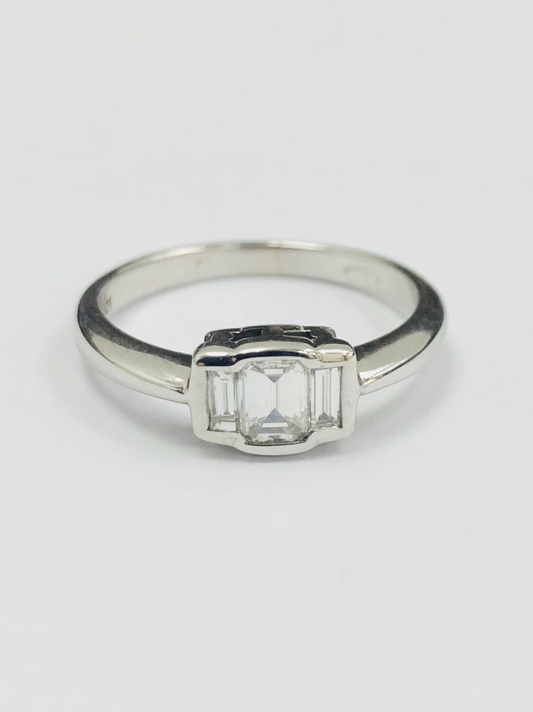 18ct White Gold Emerald Cut three stone Diamond ring. 0.60cts