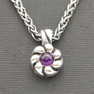 ROUND PENDANT WITH AMETHYST SET IN OXIDIZED STERLING SILVER