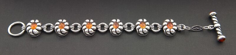 WOMEN'S STERLING SILVER TOGGLE BRACELET WITH OVAL AMBER SET IN FLOWERS