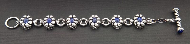 WOMEN'S STERLING SILVER TOGGLE BRACELET WITH OVAL LAPIS LAZULI SET IN FLOWERS